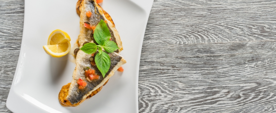 Sea bream fillet with tomatoes and capers